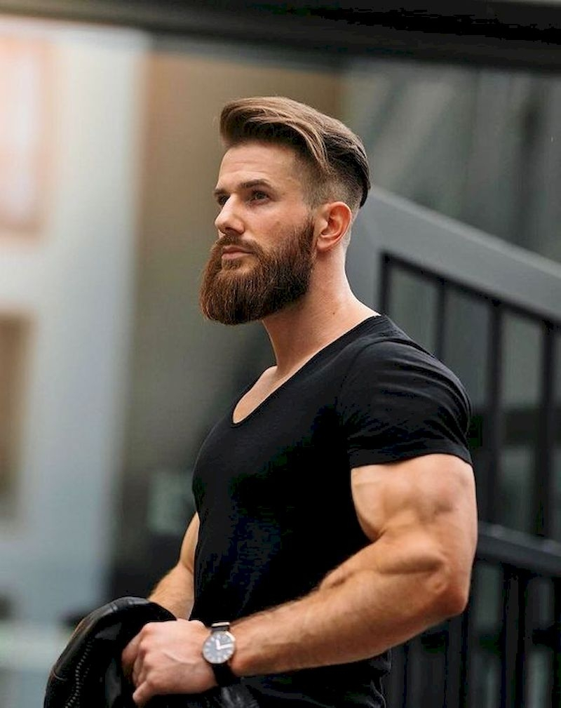 Long beard with muscular body and wearing a black t-shirt