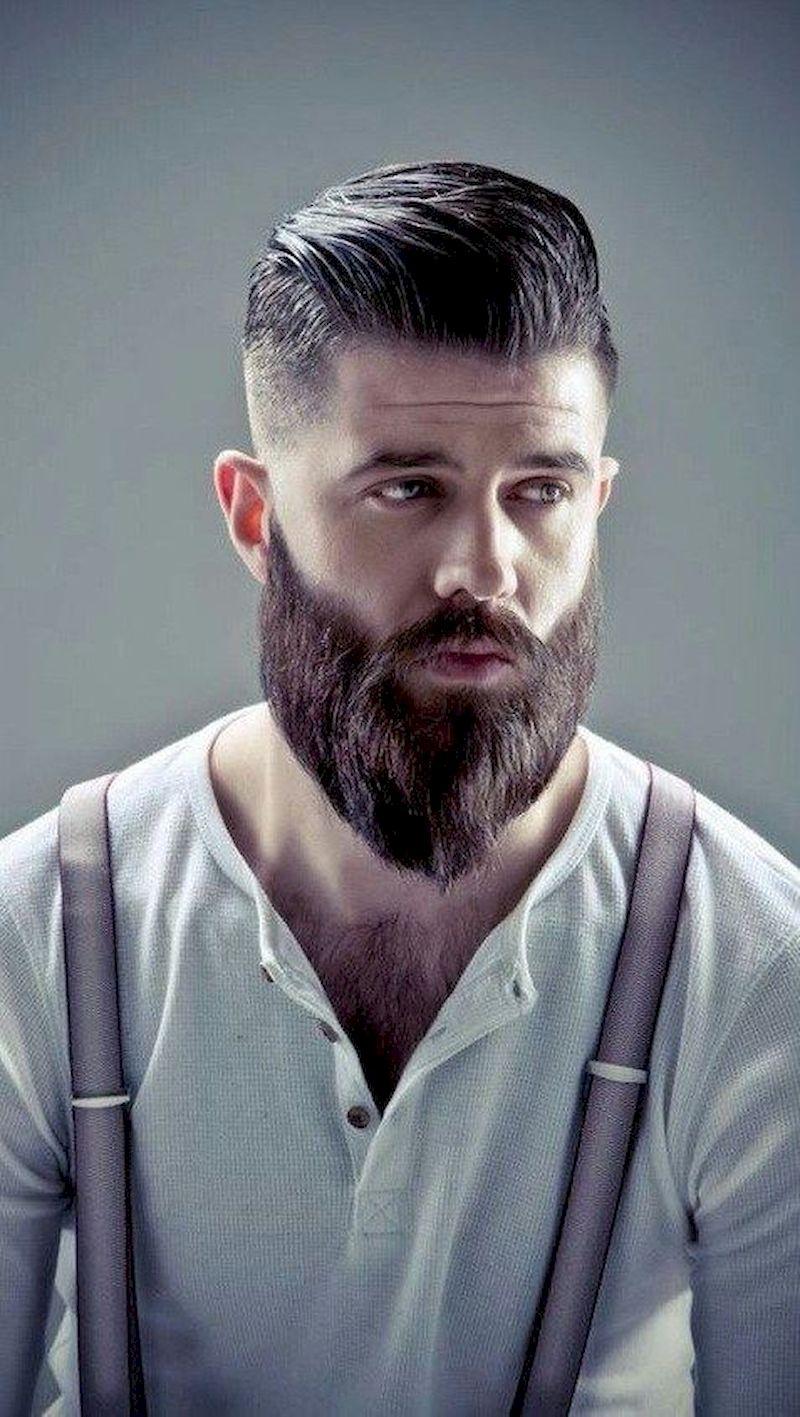 The hairstyle is combed to the side with a long straight beard