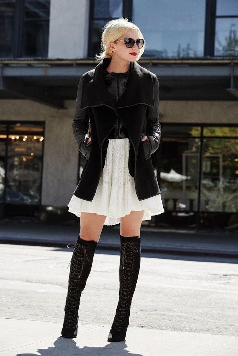 White-skirt-moto-jacket-and-knee-high-boots.-