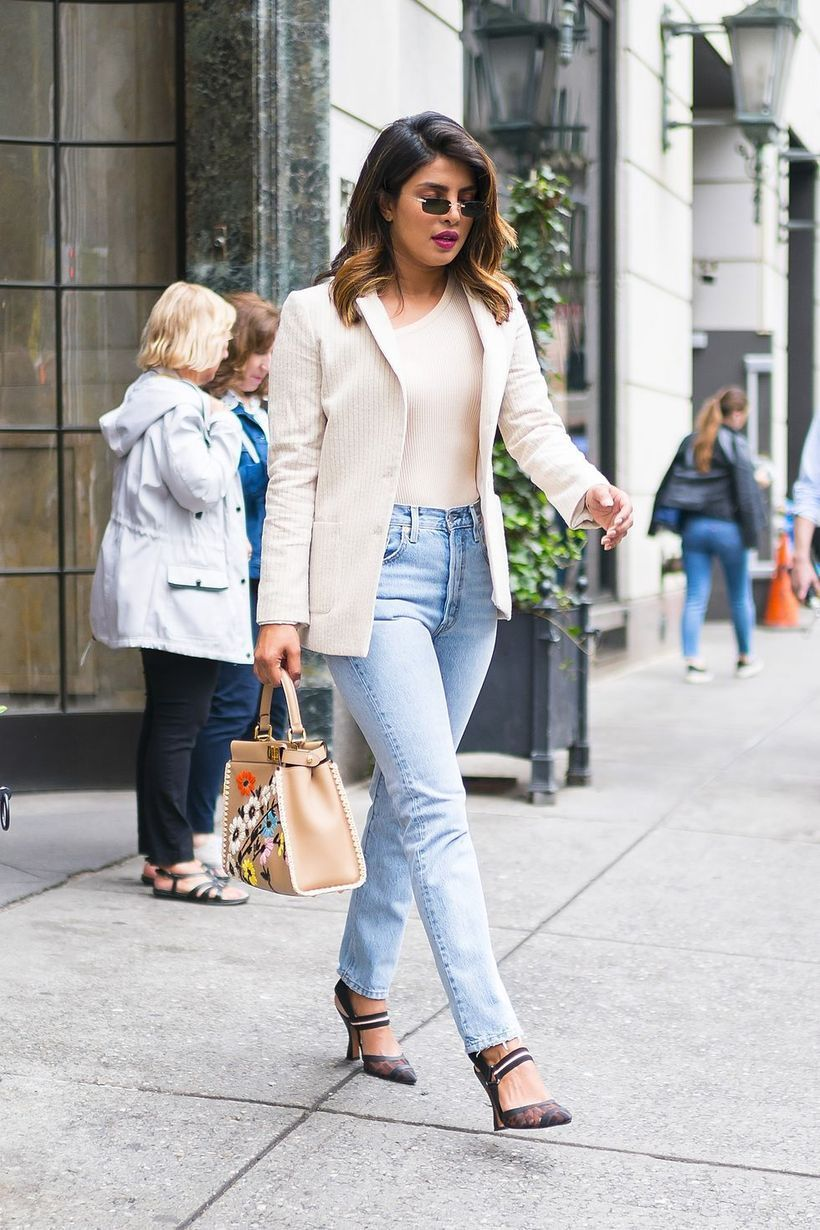 White outer with white t-shirt, denim pants and high heels