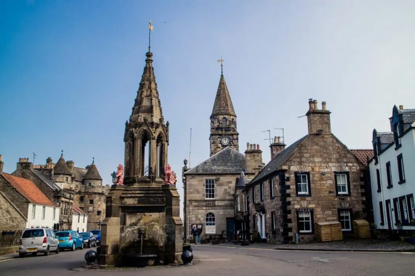 The market cross on the main square of Falkland - behind it, the Covenanter Hotel; both featured heavily in the famous Outlander TV series.
