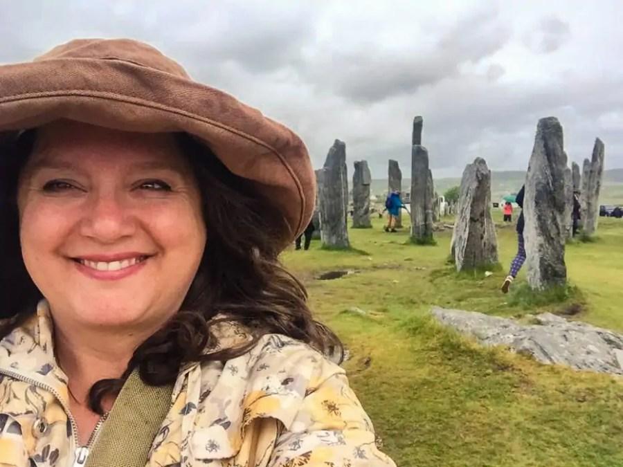 Nancy exploring the Calanais Standing Stones on an Outlander tour in Scotland.