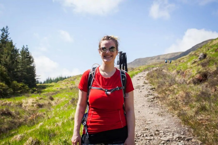 A woman in hiking clothes on the West Highland Way.