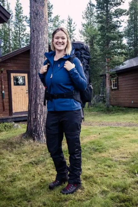 Girl carrying the Fjallraven Abisko 65 L backpack. - The best trekking backpacks & their must-have features