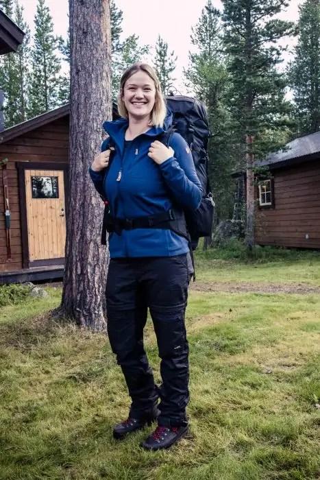 578ed79baedc Girl carrying the Fjallraven Abisko 65 L backpack. - The best trekking  backpacks   their