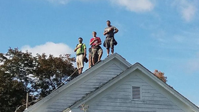 roofers-standing-national-anthem_1508269199383.jpg