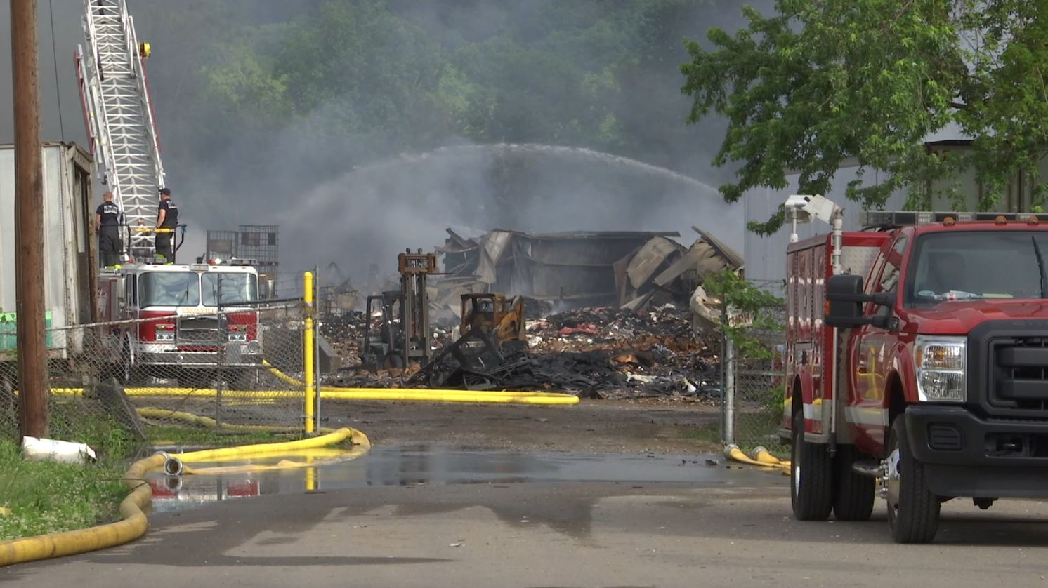 COVER PHOTO_Recycling Center fire debris with KFD_0503_1556856151439.JPG.jpg