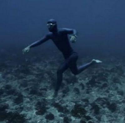 underwater man walking on ocean bed