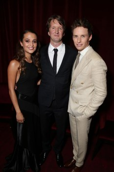 Director Tom Hooper could've made a more concise, insightful film. Here he is with his two leads, Alicia Vikander and Eddie Redmayne.