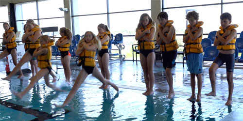 stride entry wearing a lifejacket