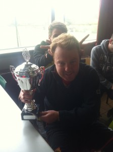 Top scorer Rob Sterry shows off the latest addition to the WIFC trophy cabinet