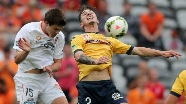 Challenge: Central Coast's Storm Roux contests the ball with James Donachie of the Roar.