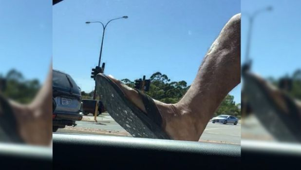 Thongs and all, the driver's mirror is on the receiving end of a hefty kick.