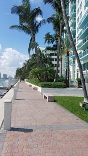 Wide Baywalk behind Floridian Condominium.