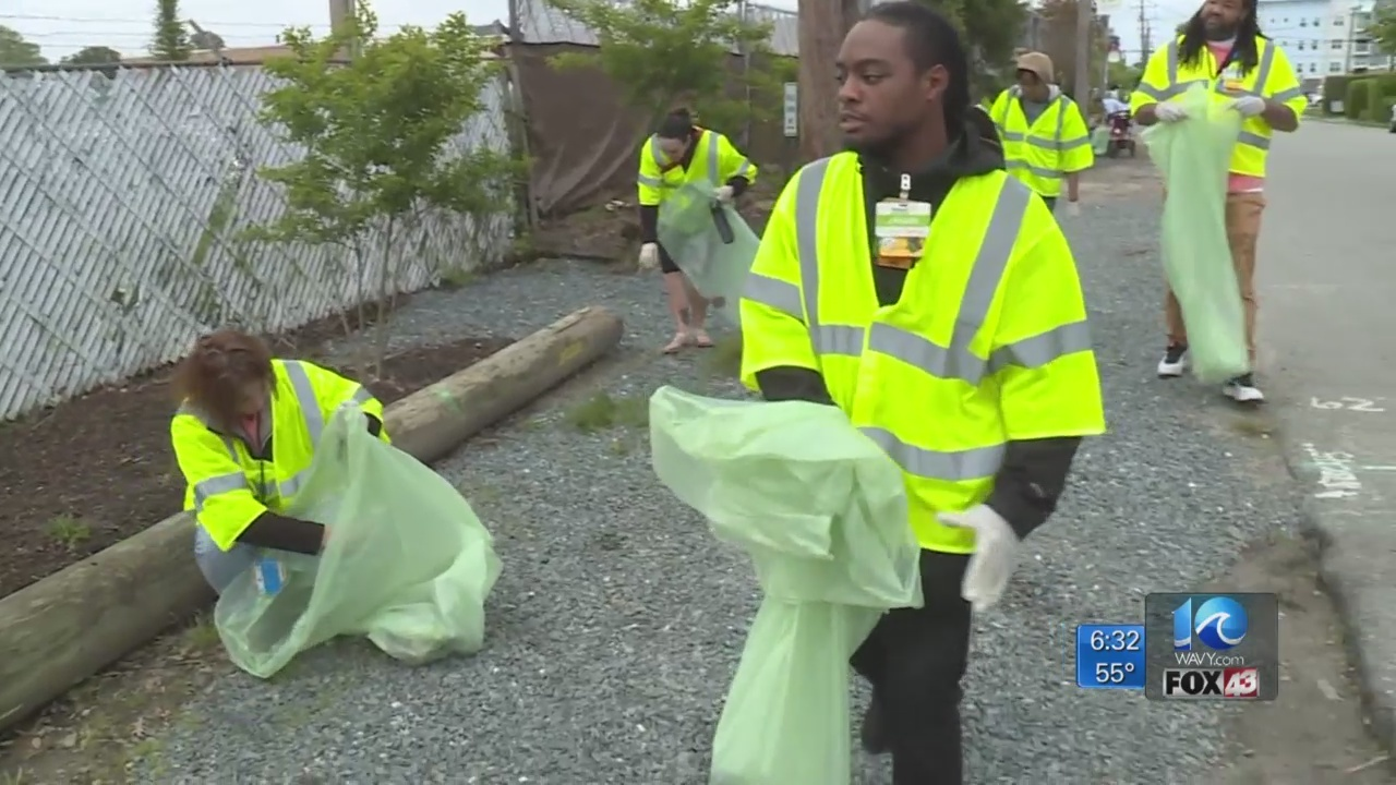 Volunteers join in to clean beach after Something in the Water