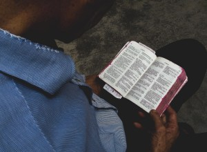 man reading a chinese bible