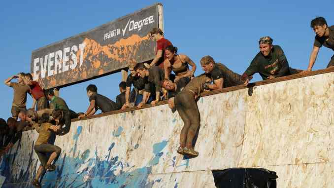 Obstacle course race camaraderie