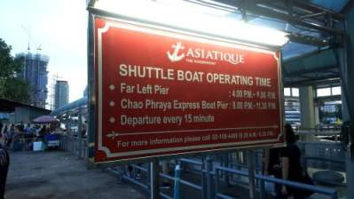 Asiatique ferry sign with operating hours