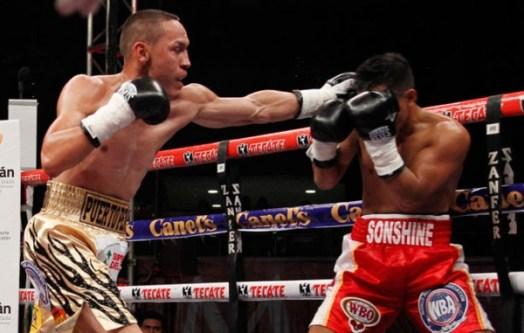 Estrada crushes Asenjo to retain fly belts