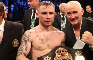 Carl Frampton celebrates beating Leo Santa Cruz