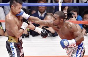 Jezreel Corrales punches Takashi Uchiyama during their bout on Wednesday. | KYODO