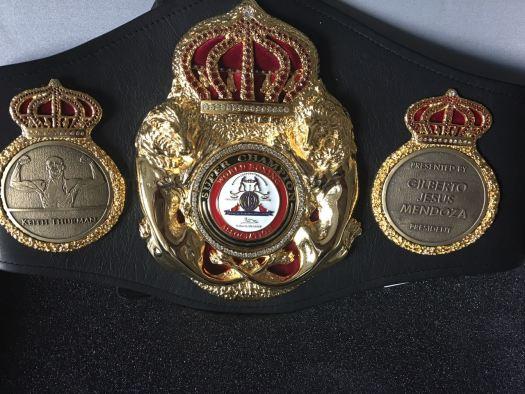 Mendoza presents personalized belt to Thurman