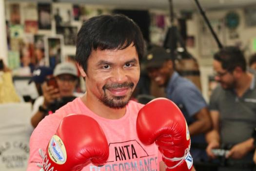 Pacquiao shows guns and Broner promises surprise in Los Angeles