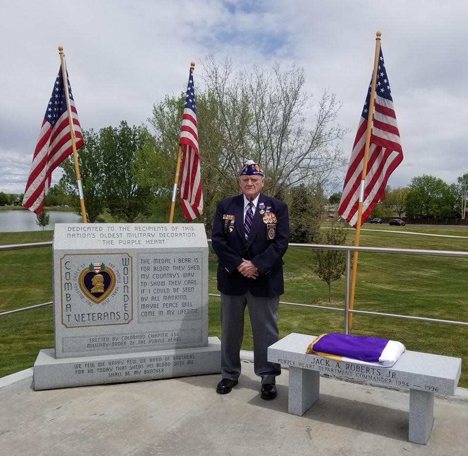 veteran standing near memorial