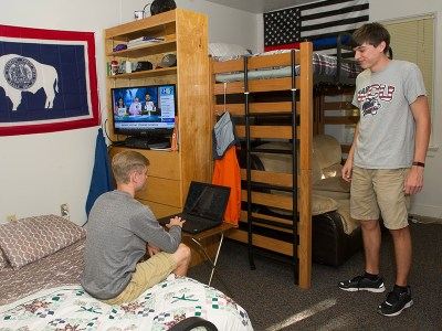 Two male students in their room in Reynolds Hall.