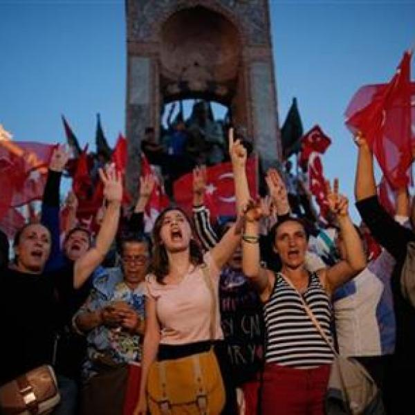 People chant slogans as they gather at a pro-government rally in central Istanbul's Taksim square, Saturday, July 16, 2016. Forces loyal to Tur_173192