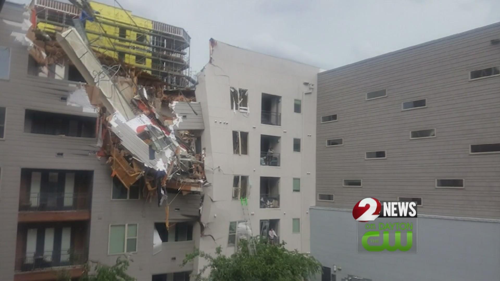 1 killed when crane topples on Dallas apartments