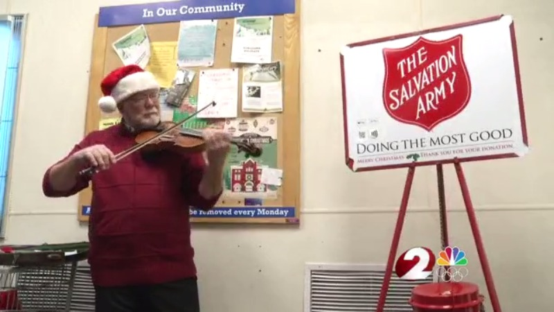 I Love Dayton, Bell ringer plays violin