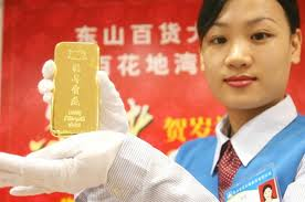 Chinese woman holding a gold bar 2