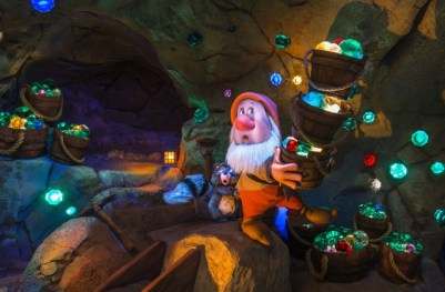 Seven Dwarfs Mine Train image showing the use of projection mapping on the dwarf's face. Copyright Disney.