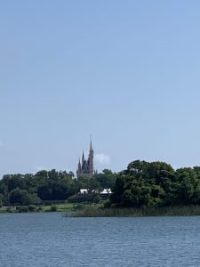"""alt=""""View of the Seven Seas Lagoon and Cinderella Castle from the Grand Floridian running trail."""""""