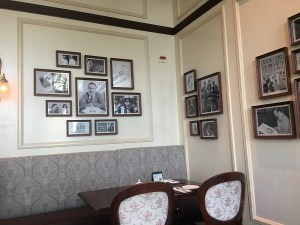 "alt=""Wall photos at Walt's Cafe at the Hong Kong Disneyland Resort."""
