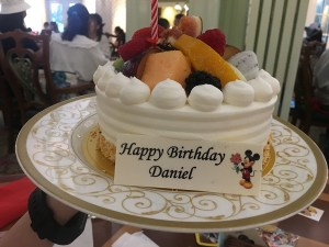 "alt=""Daniel's birthday cake at the Enchanted Garden Restaurant."""