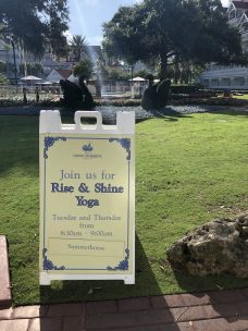 """alt=""""Rise and Shine yoga class information sign at the Grand Floridian Resort."""""""