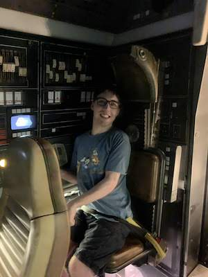 "alt=""Engineer Andrew Prince on the Millennium Falcon: Smugglers Run attraction."""