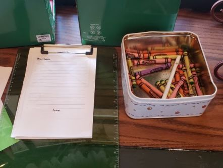 """alt=""""Paper and crayons for writing a letter to Santa at Ye Olde Christmas Shoppe at Magic Kingdom."""""""