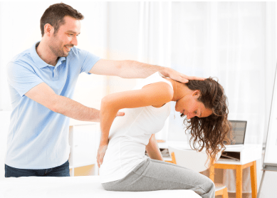 physiotherapist helping a patient sitting on the bed relieve back pain