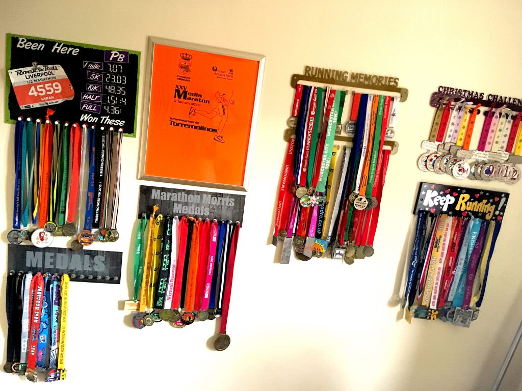 tailored training plan client Sarah's medal collection