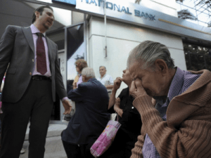 These heartbreaking pictures of elderly people lining up outside banks sum up the chaos in Greece right now + MORE