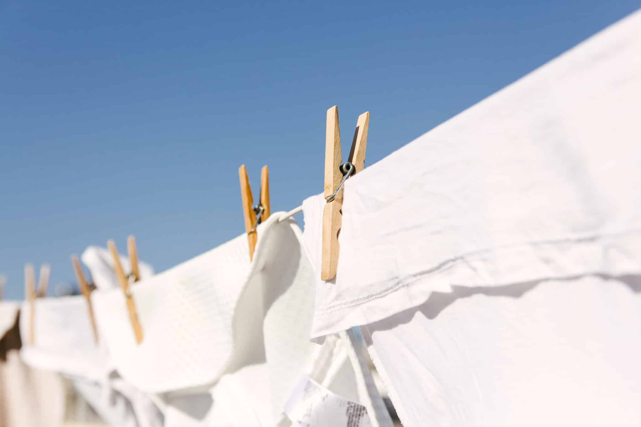 hanging white clothing out in the warm sun will help to sun bleach them and keep the whites white.