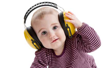 Baby wearing protective ear muffs