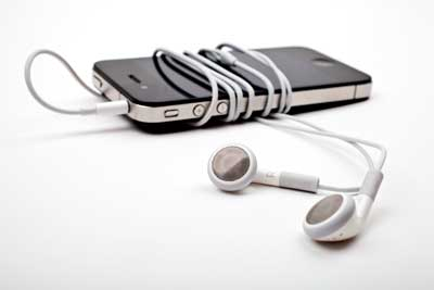 earbuds wrapped around phone