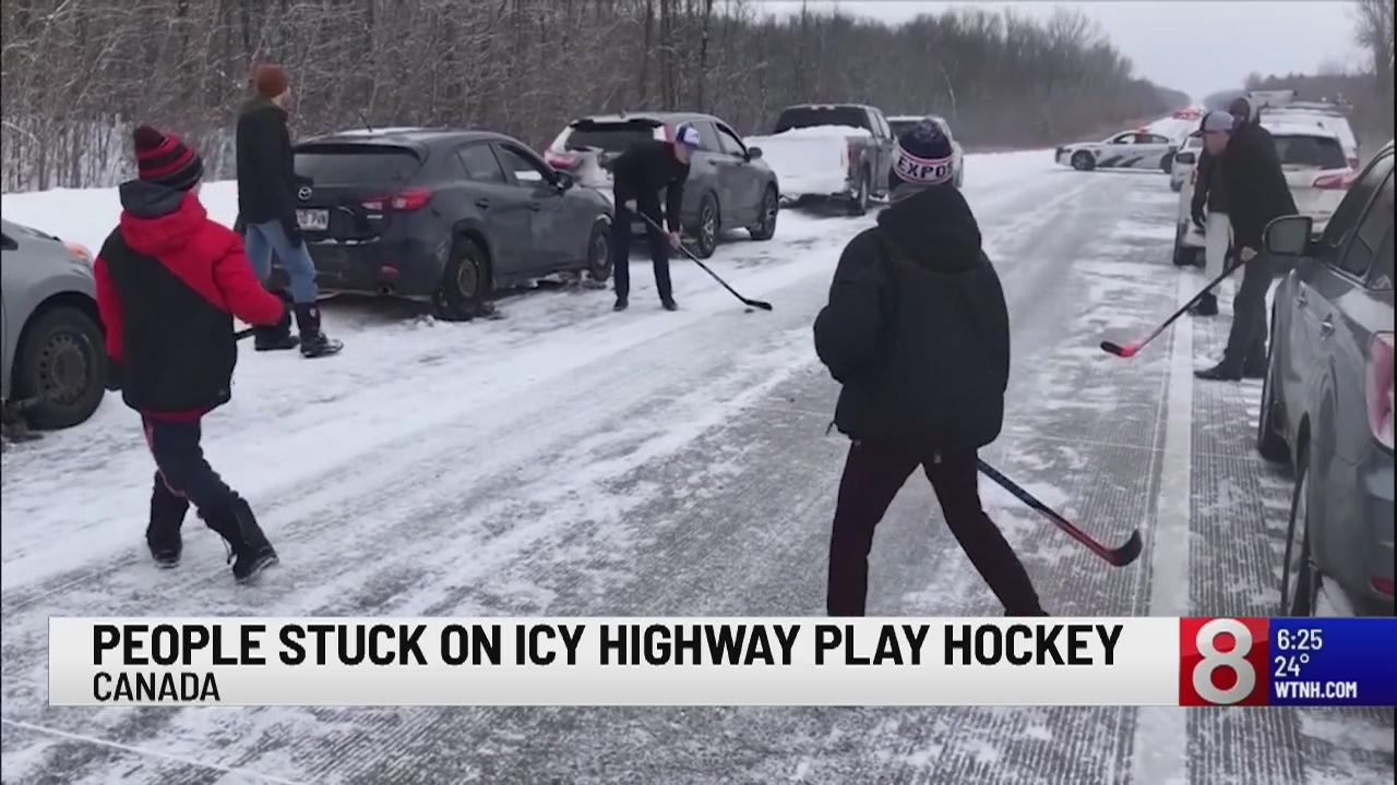 People stuck on icy Canada highway play hockey