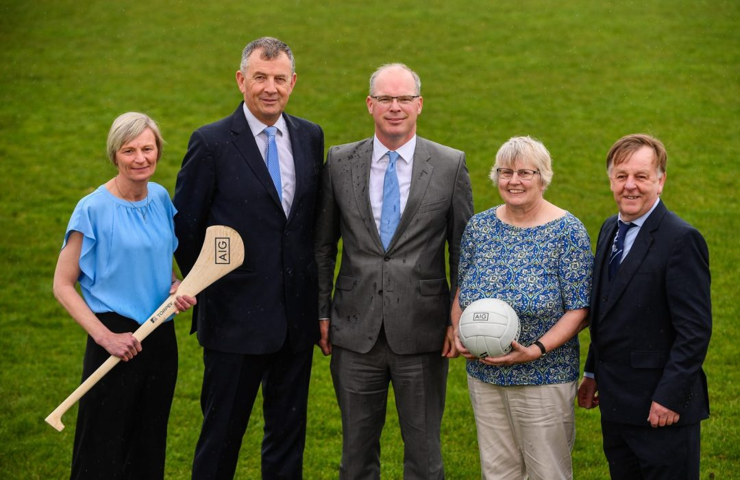 Dublin Camógie Chairwoman Jenny Byrne holding a hurl, Dublin GAA CEO John Costello, AIG General Manager Declan O'Rourke,Dublin LGFA Secretary Mary O'Connor holding a white ball and Dublin County Board Vice-Chairman Mick Seavers On A Green Pitch at the announcement of AIG extending their sponsorship of Dublin GAA