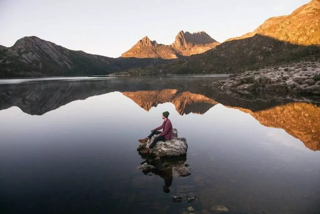 "Microadventures with @benleodavis 4/5 ""We left our hotel at 3am in -8 degree temp and drove 2 hours out to Cradle mountain. We arrived to a spectacular view of mountain surrounds, then walked to the boat shed where this shot was taken. The lake is only this still for 20 days a year making for unbelievably clean reflections. We were very lucky to get such great conditions considering we were only in Tasmania for a short time."" #weareexplorers"