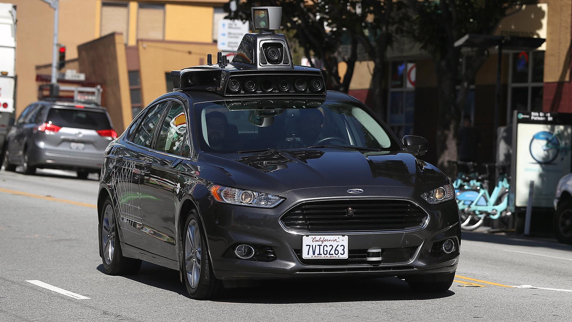 Self-driving Uber car on the road-159532.jpg49715493